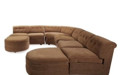An upholstered sectional sofa mid-20th century Comprised of 5...