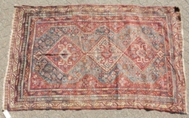 A LARGE OLD PERSIAN SHIRAZ RUG with three main diamond