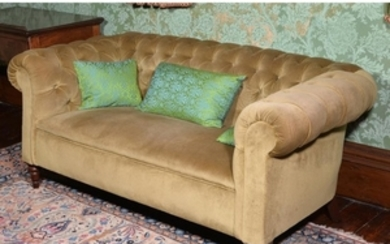 A mahogany and button upholstered sofa