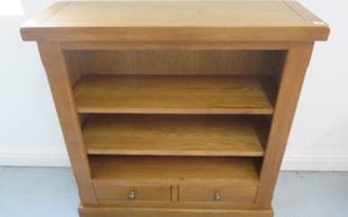 A new kettle oak book case with two shelves and two base dra...