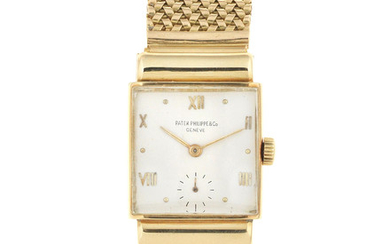 Patek Philippe. An 18K gold manual wind rectangular bracelet watch with hooded lugs