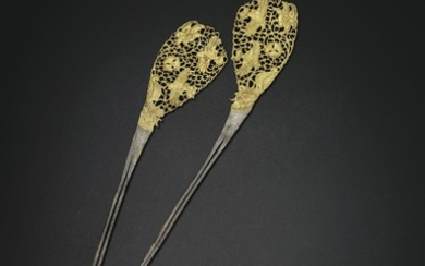 A RARE PAIR OF PARCEL-GILT SILVER HAIRPINS, TANG DYNASTY (AD 618-907)