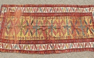 AN OLD CAUCASIAN RUNNER with typical motifs within a