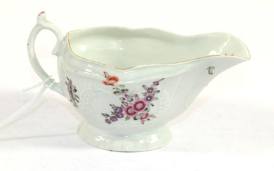 A Worcester Porcelain Sauce Boat, circa 1770, painted with flower...