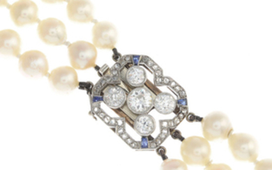 A cultured pearl three-row necklace, with mid 20th century platinum and gold, diamond and sapphire clasp.
