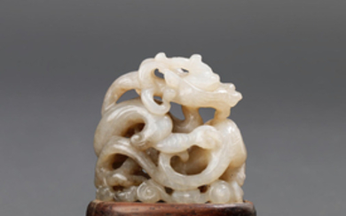 A rare white and brown jade reticulated 'dragon' finial