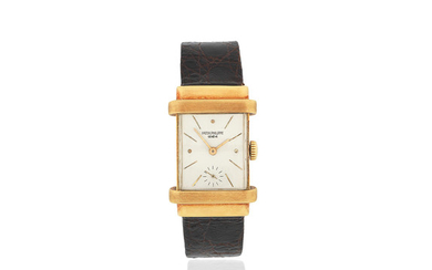 Patek Philippe. An 18K gold manual wind rectangular wristwatch with hooded lugs