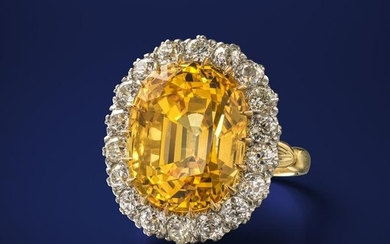 A fine yellow sapphire and diamond cluster ring, t…