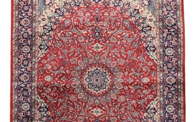 Oriental rug, classic medallion design with ornaments, entwined branches, flowers and foliage on red base. 20th century. 233×169 cm.