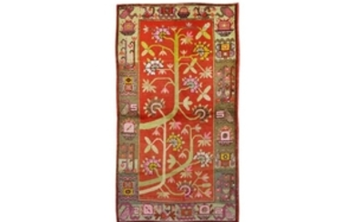 A KHOTAN RUG, EAST TURKESTAN
