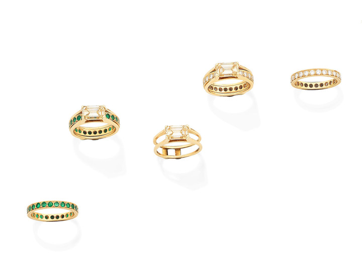 A fancy coloured diamond ring, a diamond eternity ring, and an emerald eternity ring