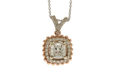 A diamond pendant set with a cushion-cut and numerous brilliant-cut diamonds, mounted in 14k white and rose gold, on a 14k white gold necklace. (2)