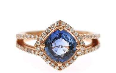 A sapphire and diamond ring set with a fancy-cut sapphire, encircled with numerous brilliant-cut diamonds, mounted in 18k rose gold. Size 56.