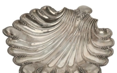 Presentation dish molded in shell shape and finished with 3 round balls of silver.