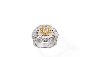A diamond and coloured diamond dress ring