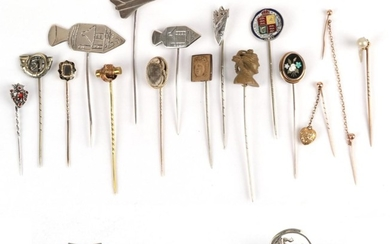 Seventeen Stick Pins, including a pearl that converts from a...
