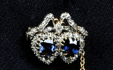 A late Victorian silver and gold, blue spinel and rose-cut diamond double heart brooch.
