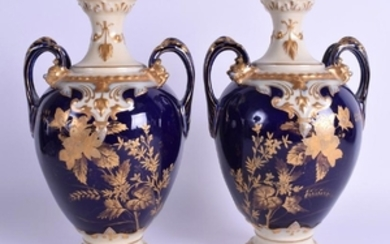 A PAIR OF FRENCH LIMOGES PORCELAIN VASES decorated with