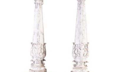 A PAIR OF PAINTED AND CARVED TIMBER OBELISKS, the …