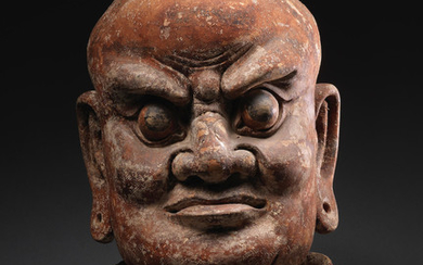 A rare carved wood head of a Lokapala