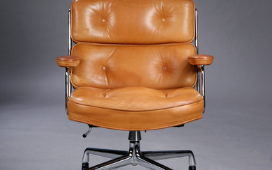Charles Eames. Vintage office chair. Time-Life Lobby Chair, patinated brown aniline leather