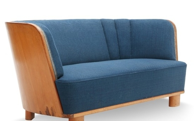 Danish furniture design: Curved sofa with beech legs, light mahogany shell. Upholstered with blue wool. Manufactured by Søren Willadsen, 1940s.