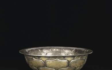 A VERY RARE AND IMPORTANT LARGE PARCEL-GILT SILVER BOWL, TANG DYNASTY (AD 618-907)