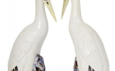 A pair of Chinese porcelain models of...