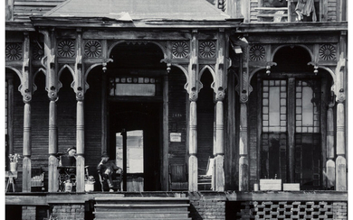 Walker Evans (1903-1975), Boarding House with Two Men Seated on Porch, Birmingham, Alabama (1936)