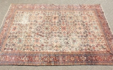 A LARGE PERSIAN KARAJA CARPET with seven central