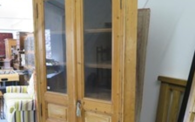 A 19th Century style pine corner cupboard with two doors and...