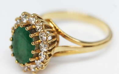 A diamond and emerald cluster ring, crafted in yellow metal ...