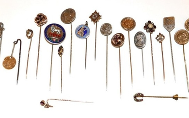 Twenty-Two Stick Pins, including a ruby diamond and pearl example,...