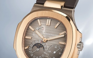 Patek Philippe, Ref. 5712GR A very rare and attractive white and pink gold wristwatch with power reserve, date, moonphases, box and certificate