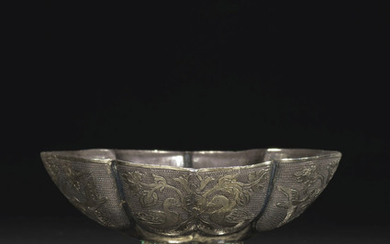A FINE SMALL PARCEL-GILT SILVER QUATREFOIL CUP, TANG DYNASTY (AD 618-907)