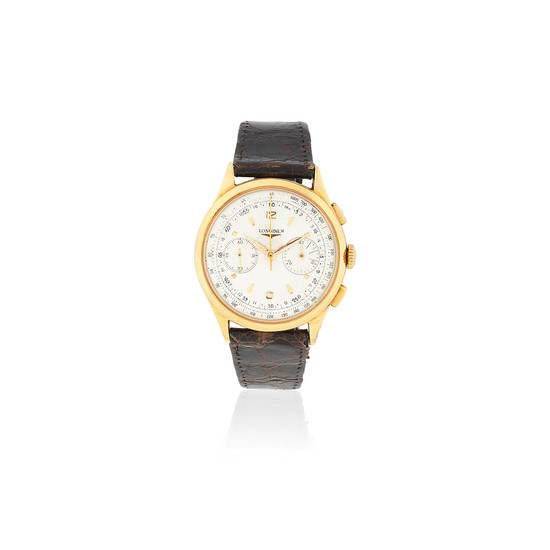 Longines. An 18K gold manual wind chronograph wristwatch