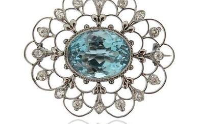 An aquamarine and diamond brooch, the oval-shaped aquamarine...