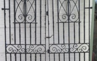 A pair or large iron gates with their fittings, 234cm x 83cm