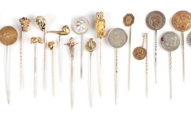 Twenty Stick Pins; including a knot, cased; coin examples; an...