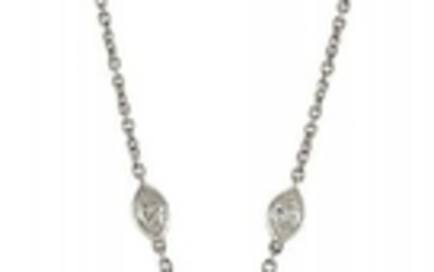 A diamond pendant necklace, composed of four...
