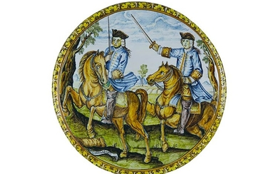 Tondo Round on board slightly enlarged. Maiolica painted in polychromy;...