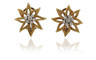 A pair of diamond flowerhead earrings, set with...