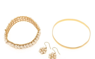 A pearl jewellery collection comprising two bangles and a pair of ear pendants partly set with cultured fresh water pearls, mounted in 21.5k gold. (4)