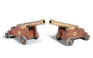 A PAIR OF 18TH/19TH CENTURY BRASS CANNONS, each wi…