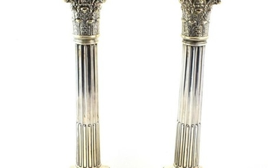 A Pair of Victorian Silver Candlesticks, by James Dixon and...