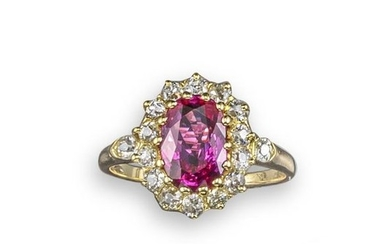 A ruby and diamond cluster ring, the oval shaped r…
