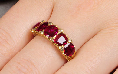 An Edwardian 18ct gold Burmese ruby five-stone and diamond ring.
