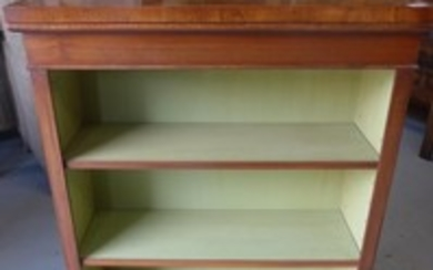 A walnut bookcase with two adjustable shelves made by a loca...