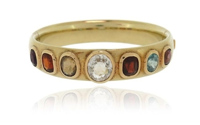 A gem-set gold bangle, the plain gold bangle...