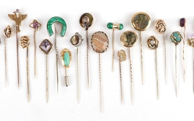 Twenty-Two Stick Pins, including a moss agate example, an amethyst...